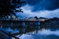 Blue reflection bridge. Bridge across river under dark blue sky Royalty Free Stock Photos