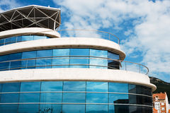 Blue reflections. Modern building with reflections on the glass windows royalty free stock photos