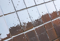 Blue Reflections and Grunge on Wet rRed Tiles Royalty Free Stock Photo