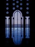 Blue reflections thru glass windows framing door i Stock Images