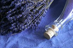 Blue relaxation. A bunch of lavender on a bath salts background Royalty Free Stock Photography