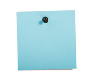Blue reminder note with black pin. On white background stock images