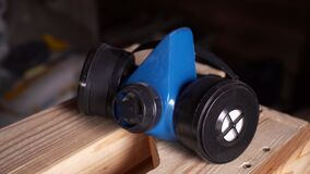 blue respirator lies on wooden boards. renovation and construction concept