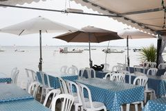 Blue restaurant terrace at an oyster farmer at the foot of the ocean to eat oysters royalty free stock photos