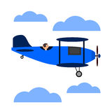 Blue retro airplane with pilot. Royalty Free Stock Photo