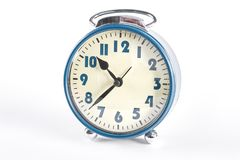 Blue retro alarm clock, white background. Classic mechanical bell clock isolated on white background. Vintage alarm clock Stock Photo