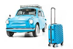 Blue retro car with luggage. Isolated on white Stock Photos