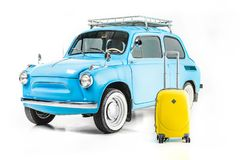 Blue retro car with luggage. Isolated on white Stock Images