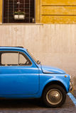Blue retro car on the street Royalty Free Stock Photography