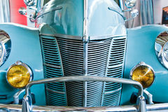 Blue retro car with yellow headlamps Stock Photos