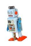 Blue retro mechanical robot toy walks isolated. On white background Royalty Free Stock Images