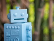 Blue Retro robot toys on Natural green leaves background Stock Image