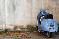 Blue Retro Scooter. On old wall Stock Photography