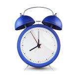 Blue retro style alarm clock isolated on white background. Stock Photo