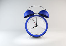 Blue retro style alarm clock on white gray background. Royalty Free Stock Images