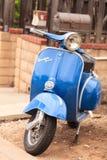 Blue retro Vespa moped Stock Photography