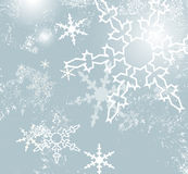Blue retro winter background. Christmas background blue with snowflake pattern and ice crystals Royalty Free Stock Images