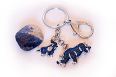 Blue Rhino with Elephant Protection Key Chain. Sodalit.  The Blue Rhino and Elephant is a powerful talisman to protect against fighting, robbery, stealing Stock Photography