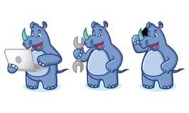 Blue Rhino Mascot with laptop Stock Photo