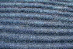Blue Ribbed Carpet Background. Blue ribbed Carpet close up royalty free stock image