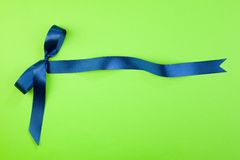 Blue ribbon. On green background Royalty Free Stock Images