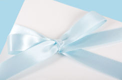 Blue ribbon. Blue satin ribbon on a white gift box Stock Photo