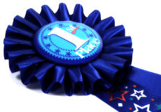Blue Ribbon. Photo of a 1st Place Blue Ribbon With Color and Blur Effect royalty free stock image