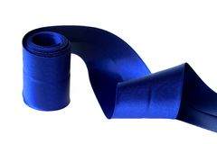 Blue ribbon. Blue curly satin ribbon Royalty Free Stock Images