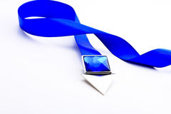Blue ribbon with arrow and blue stone Stock Photo