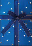 Blue ribbon and bow on the gift Stock Image