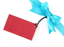Blue ribbon bow with blank red greeting card for writing message isolated on white background. For decoration and add beauty to gift box, close up top view flat stock images