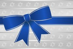 Blue Ribbon Bow Hanukkah. Blue and silver ribbon bow on silver background for Hanukkah holidays Royalty Free Stock Image
