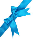 Blue ribbon with bow. Isolated on white background stock photography