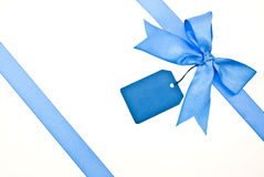 Blue ribbon and bow with label Stock Photos