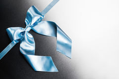 Blue ribbon bow on metal Royalty Free Stock Images