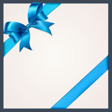 Blue ribbon with bow on a white background.  Stock Photos