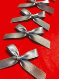 Blue ribbon bows on a red background Royalty Free Stock Image