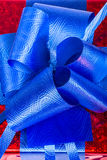 Blue ribbon on gift box Stock Images