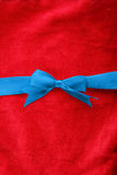 Blue ribbon over red Royalty Free Stock Photos