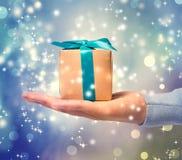 Blue ribbon present box on hand Royalty Free Stock Photography