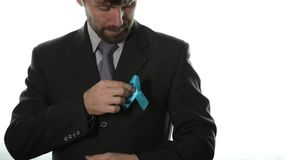 Blue ribbon. prostate cancer awareness and violence against children. healthcare and medicine concept. stock footage