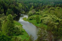 The blue ribbon of the river from the height of the mountains. Wild nature, taiga. Tourism. Far East, Sakhalin Island, Russia. royalty free stock photos