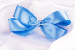 Blue ribbon satin bow Stock Photography
