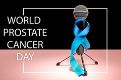Blue ribbon symbolic of prostate cancer awareness campaign and men`s health in November royalty free stock photo