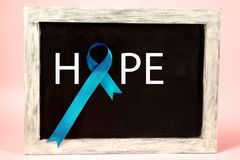 Blue ribbon symbolic of prostate cancer awareness campaign and men`s health in November stock image