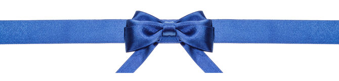 Blue ribbon and symmetric bow with horizontal ends Royalty Free Stock Photography