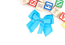 Blue Ribbon with Toy Blocks Royalty Free Stock Images