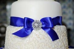 Blue ribbon on wedding cake Stock Photography