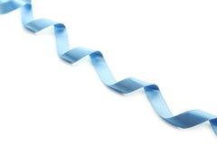 Blue ribbon on white background. Stock Photos