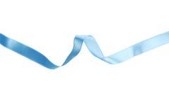 Blue ribbon on white background. Royalty Free Stock Photos